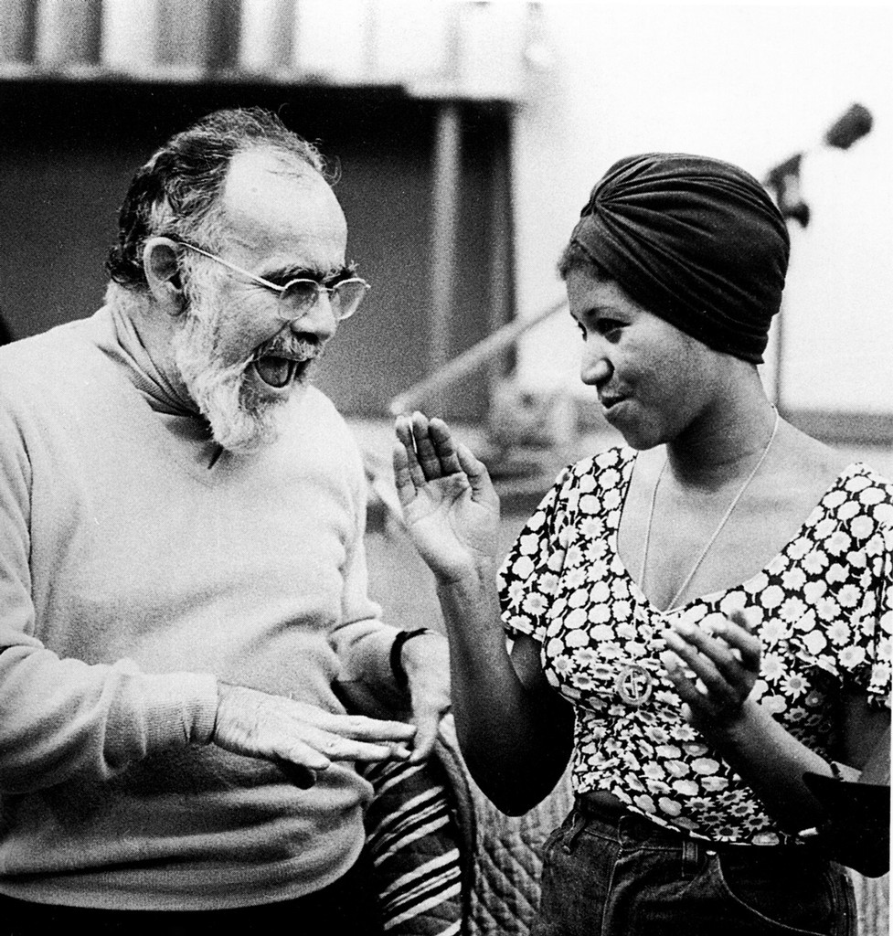 Jerry Wexler and Aretha Franklin in a recording studio circa 1960s.