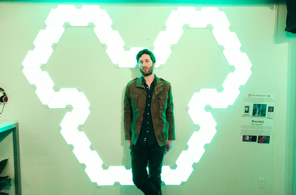 Matt Medved, Senior Editor at Billboard/Billboard Dance poses in front of neon Deadmau5 sign at the 'Lost of Stuff in a Store' Deadmau5 pop-up shop on March 31, 2017 in New York City.