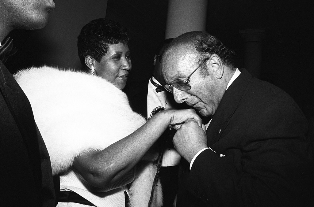Aretha Franklin and Clive Davis at a party in July 1989 in New York City.