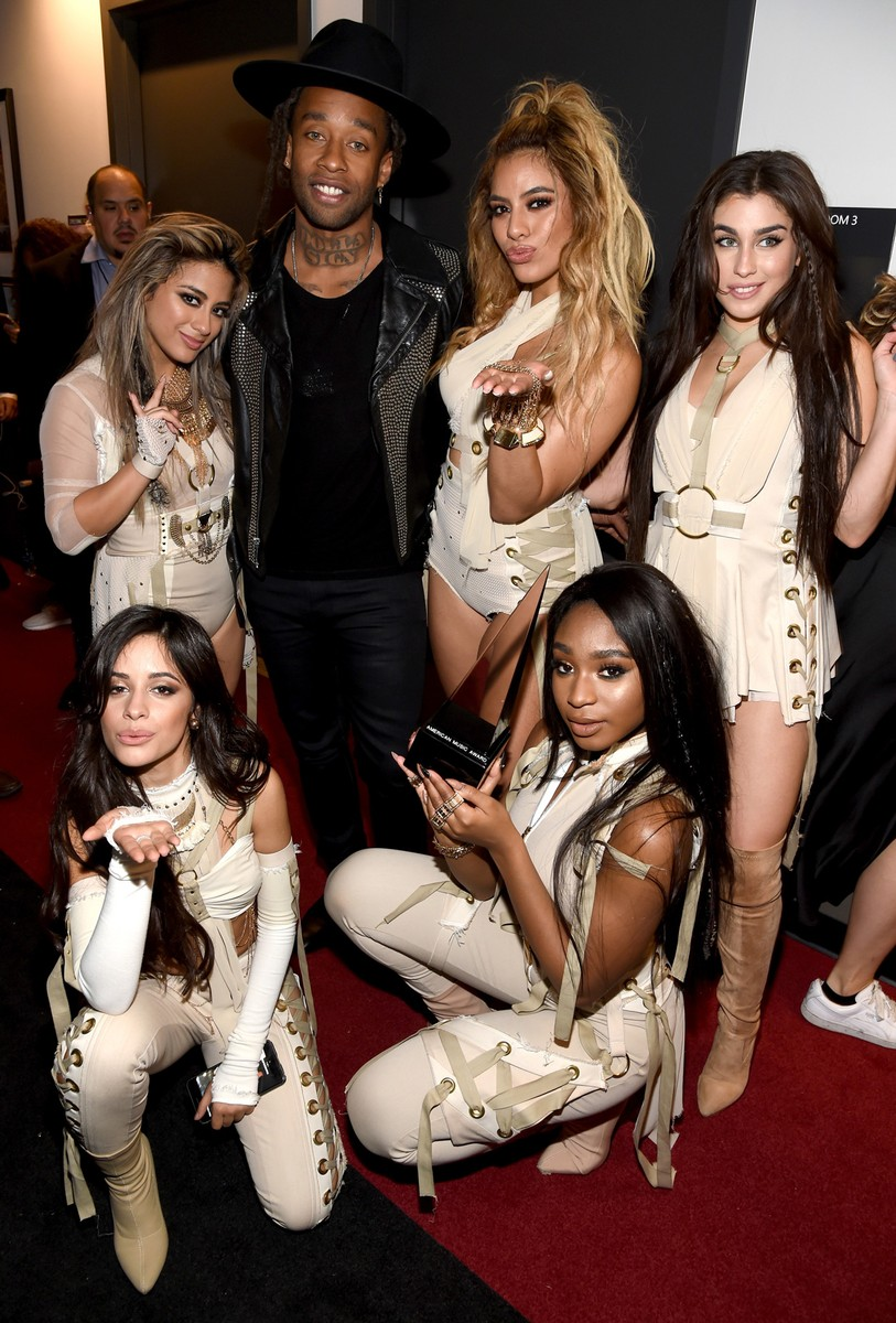 Ally Brooke, Ty Dolla Sign,  Dinah Jane Hansen, Lauren Jauregui, (bottom) Camila Cabello and Normani Hamilton of Fifth Harmony pose with Collaboration of the Year award backstage during the 2016 American Music Awards  at Microsoft Theater on Nov. 20, 2016