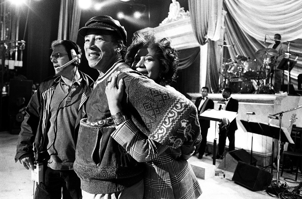 "Aretha Franklin hugs Smokey Robinson at a rehearsal for the ""Aretha Franklin: Duets"" concert to benefit the Gay Men's Health Crisis at the Nederlander Theater in April 1993 in New York City."