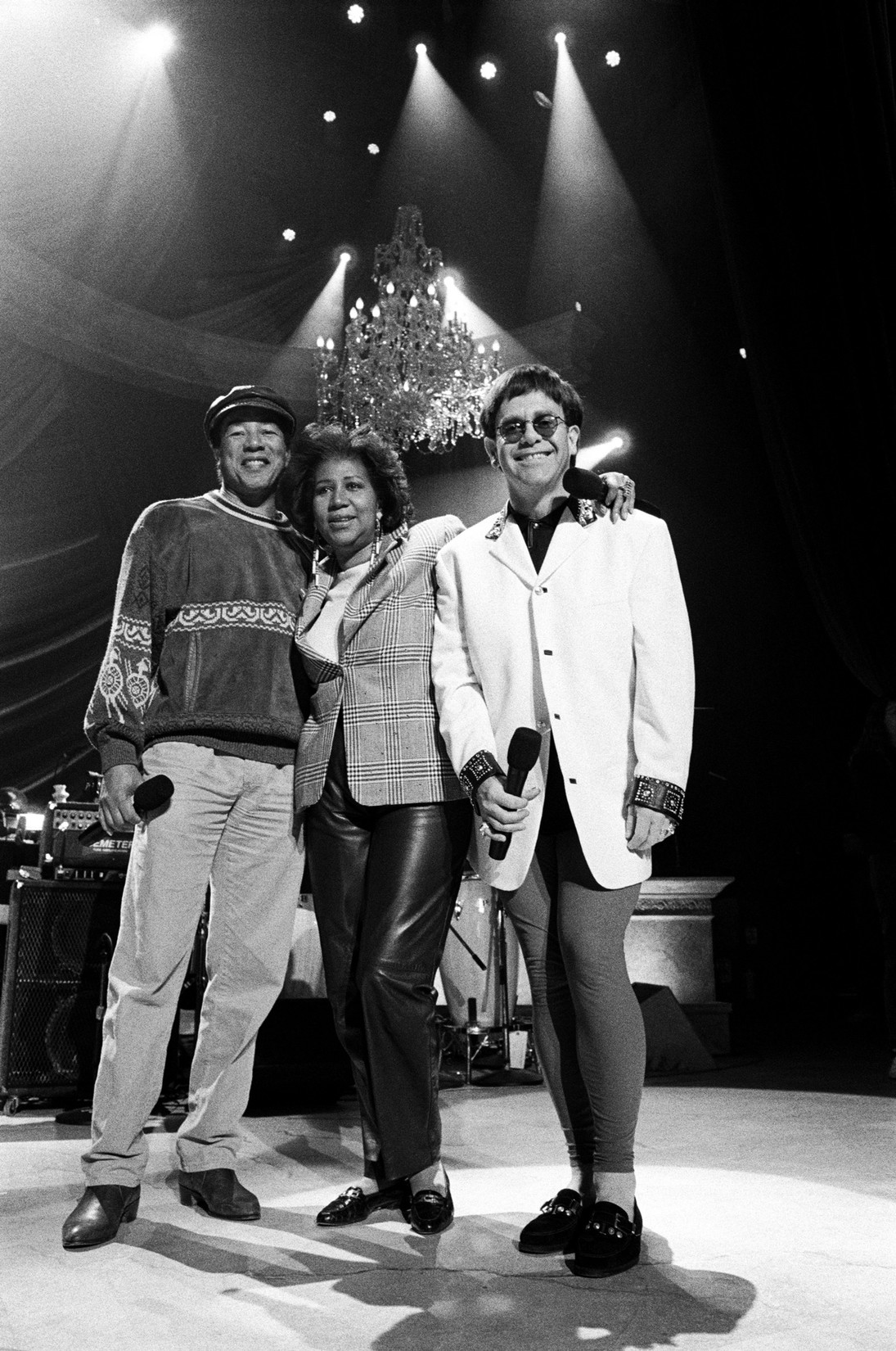 "Smokey Robinson, Aretha Franklin and Elton John at a rehearsal for the ""Aretha Franklin: Duets"" concert to benefit the Gay Men's Health Crisis at the Nederlander Theater in April 1993 in New York City."