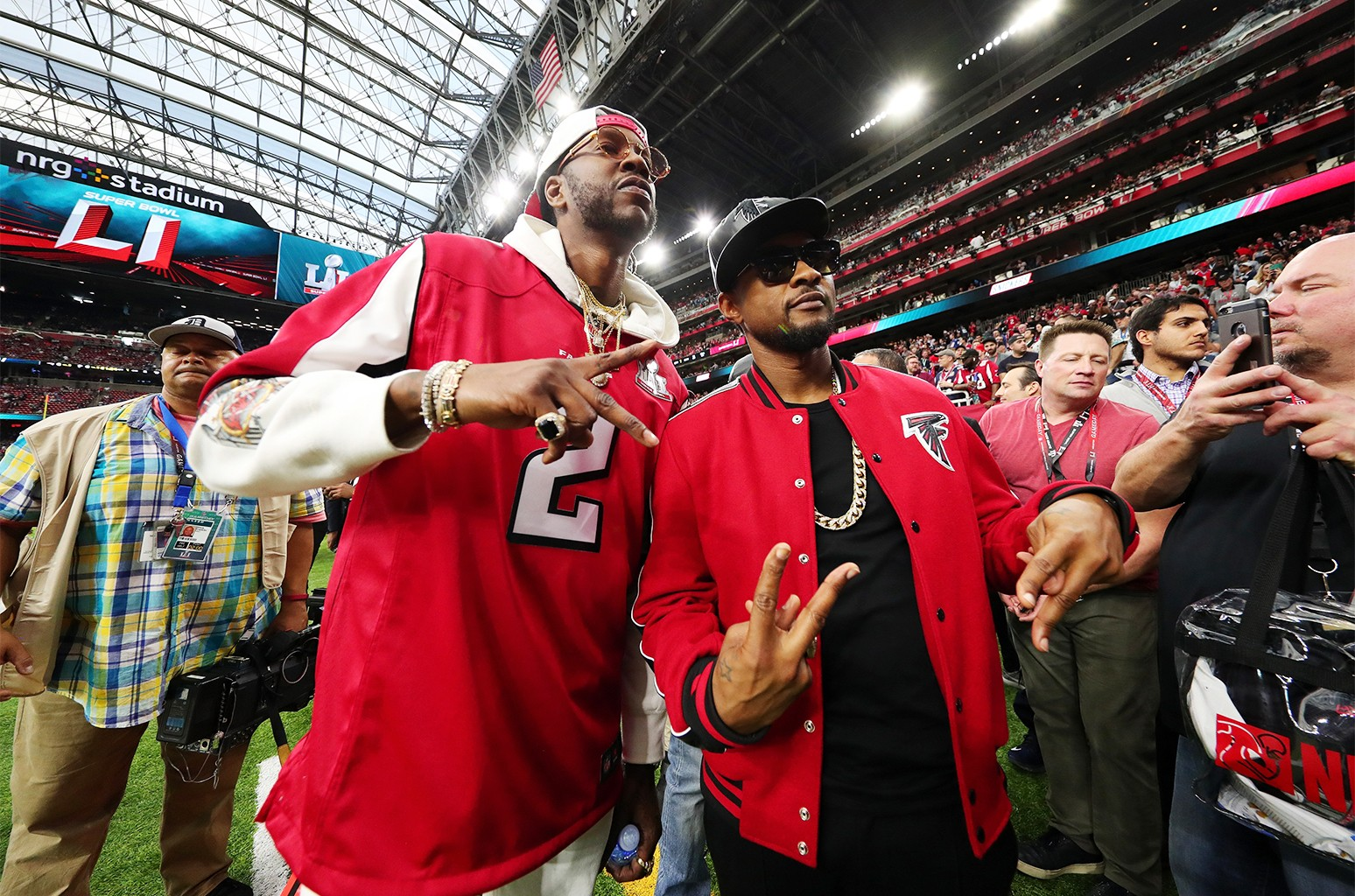 2 Chainz and Usher pose prior to Super Bowl 51 between the New England Patriots and the Atlanta Falcons at NRG Stadium on Feb. 5, 2017 in Houston.
