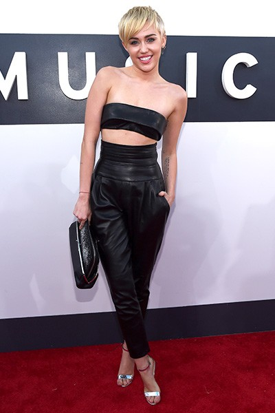 Miley Cyrus arrives at the 2014 VMAs