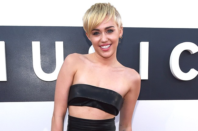 Miley Cyrus attends the 2014 VMAs