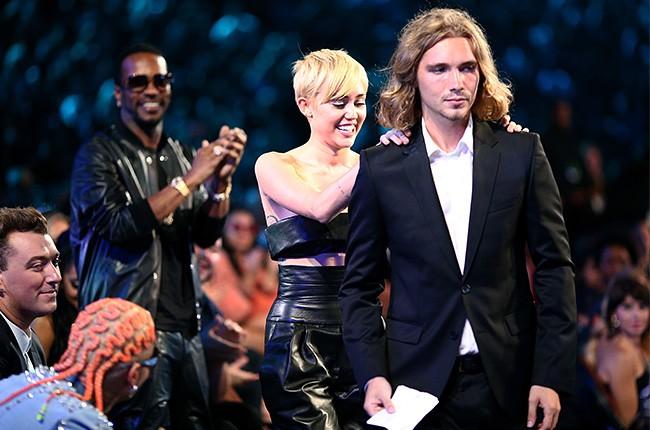 Miley Cyrus attends the 2014 VMAs