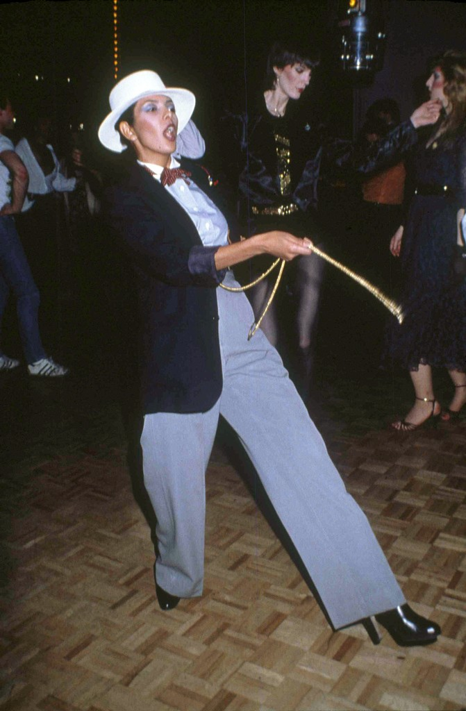 An unidentified woman in a Zoot Suit struts her stuff on the floor of New York's Studio 54 in 1979.