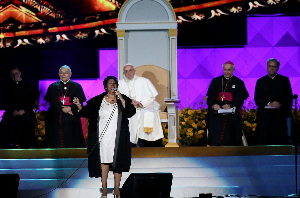 Pope Francis looks on as Aretha Franklin performs during the Festival of Families on Sept. 26, 2015 in Philadelphia