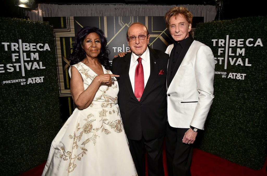 "Aretha Franklin, Clive Davis and Barry Manilow pose for a portrait backstage at the ""Clive Davis: The Soundtrack of Our Lives"" Premiere during the 2017 Tribeca Film Festival at Radio City Music Hall on April 19, 2017 in New York City."