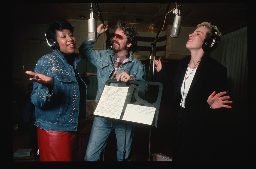 Aretha Franklin rehearses in a recording studio with Annie Lennox and Dave Stewart of Eurythmics photographed in 1985.