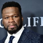 50 Cent Hilariously Reacts to Street Murals Portraying Him as Taylor Swift, Donald Trump & More