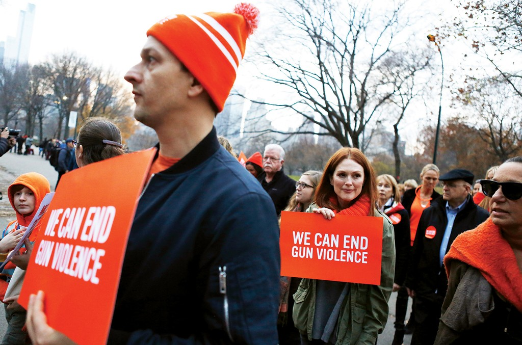 Actors Josh Charles and Julianne Moore joined supporters of  Everytown for Gun Safety in New York for the Orange Walk on Dec. 13, 2015, to mark the third anniversary of the Sandy Hook shooting.