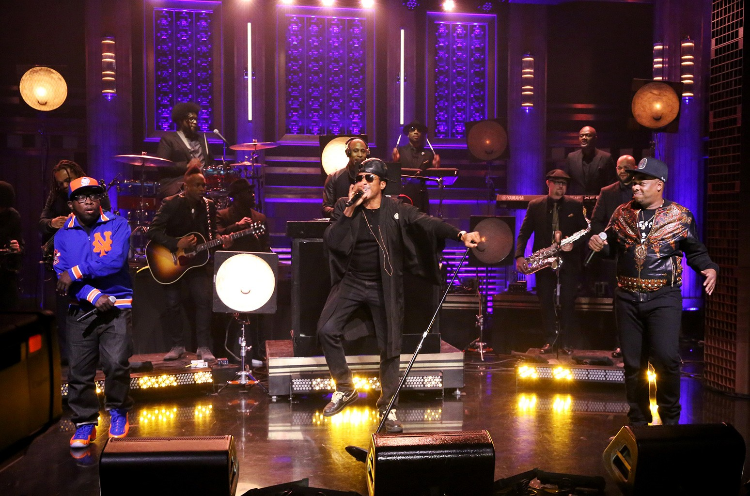 Jarobi White, Q-Tip, and Phife Dawg of musical guest A Tribe Called Quest perform on The Tonight Show Starring Jimmy Fallon on Nov. 13, 2015.