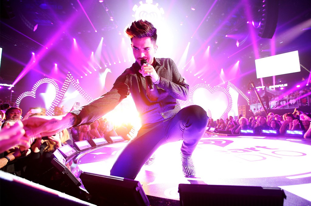 Adam Lambert performs onstage with Queen during the iHeartRadio Music Festival at the MGM Grand Garden Arena on Sept. 20, 2013 in Las Vegas.