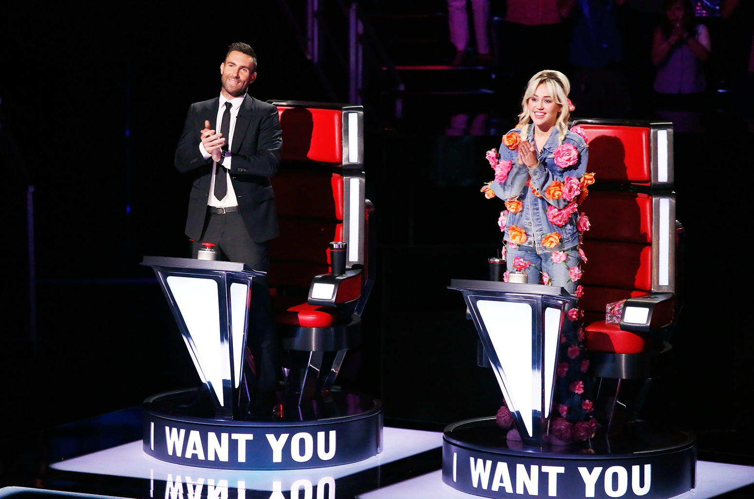 "Adam Levine and Miley Cyrus during the ""Blind Auditions"" of The Voice."