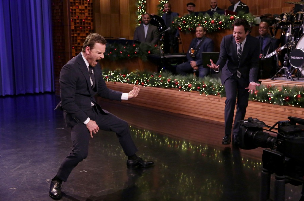 Michael Fassbender and host Jimmy Fallon have an Air Guitar Battle on The Tonight Show Starring Jimmy Fallon on Dec. 13, 2016.