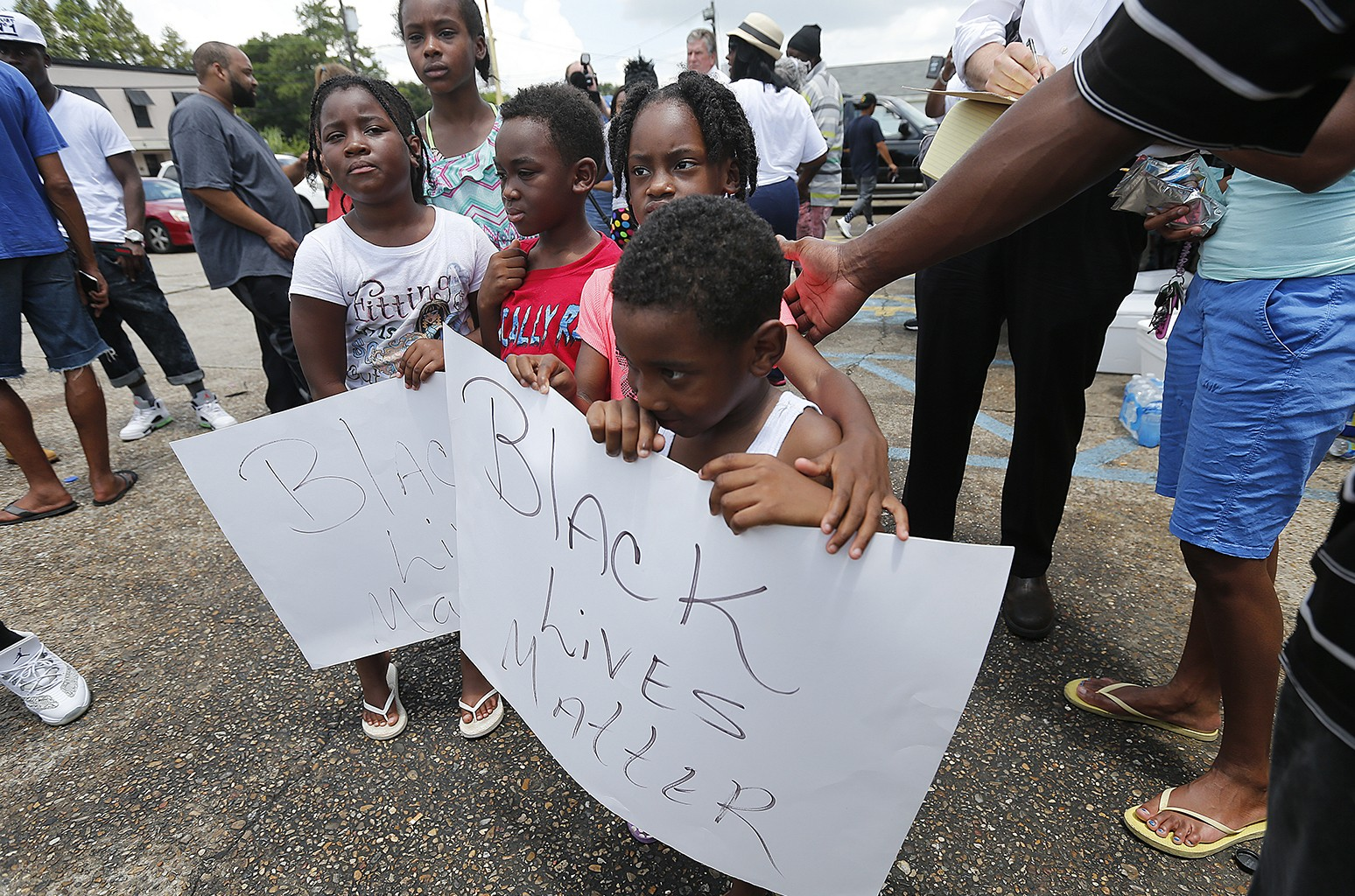 "Children hold signs reading ""Black Lives Matter"" in Baton Rouge"