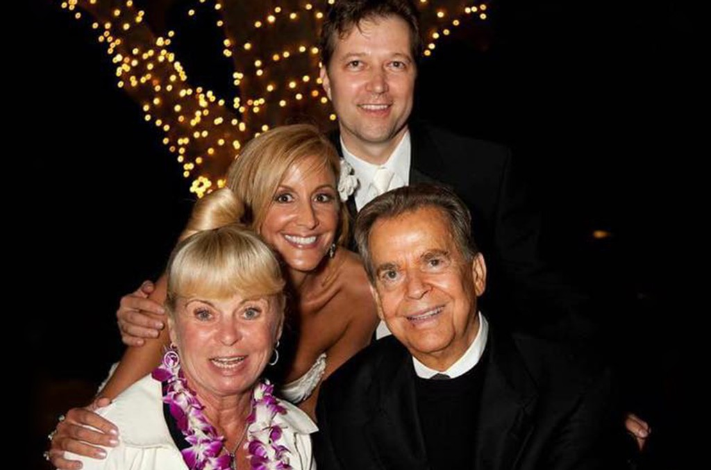 Amy Striebel Kalas and Brad Kalas photographed with Dick and Kari Clark on Amy's wedding day.