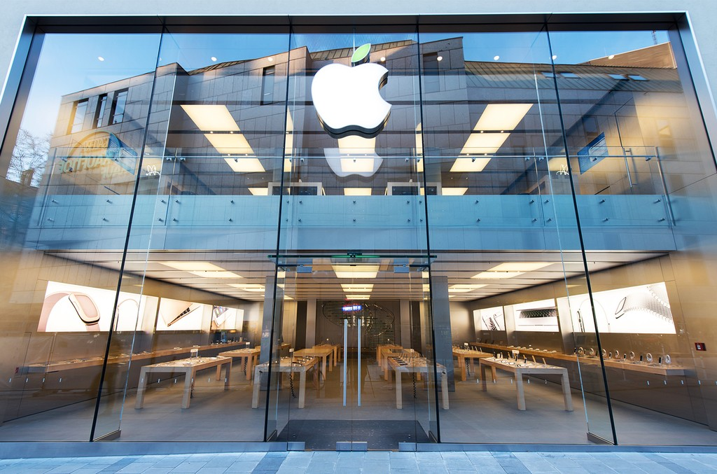 A green leaf adorns the Apple logo on Earth Day at the company's store in Rosenstrasse on April 22, 2015 in Munich, Germany.