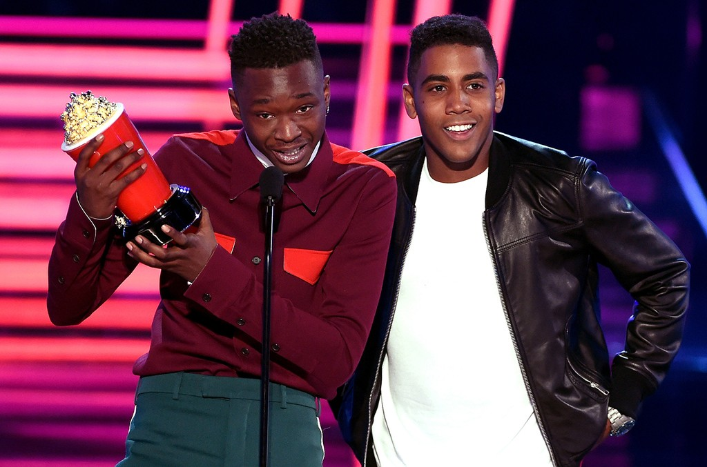 Ashton Sanders (L) and Jharrel Jerome accept Best Kiss for 'Moonlight' onstage during the 2017 MTV Movie and TV Awards at The Shrine Auditorium on May 7, 2017 in Los Angeles.
