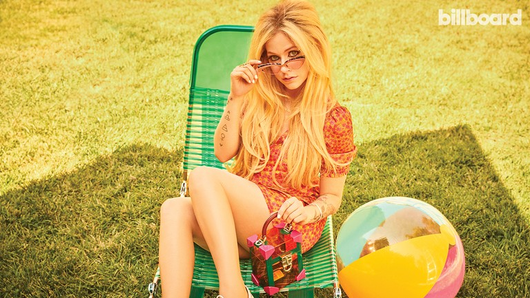 <p>Avril Lavigne photographed on Aug. 13, 2018 in Los Angeles.&nbsp&#x3B;Styling by Joseph Zee.&nbsp&#x3B;Lavigne wears a Honey Punch dress, Bonnie Clyde sunglasses, Dissona purse and Call It Spring shoes.&nbsp&#x3B;</p>