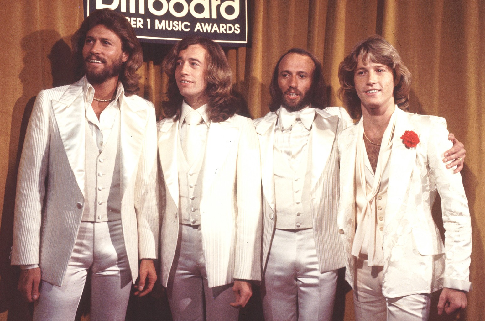 Barry Gibb, Robin Gibb and Maurice Gibb of the Bee Gees, with their brother Andy Gibb, photographed at the 1977 Billboard Music Awards