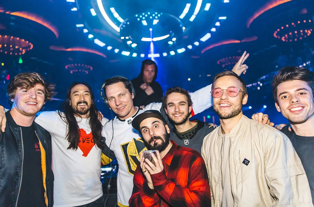 Headlining DJs (left to right) Nghtmre, Steve Aoki, Tiesto, Kaskade, Jean Paul Makhlouf of Cash Cash, Zedd, Party Favor, and Sam Frisch of Cash Cash pose for a group photo at OMNIA Nightclub's Benefit Concert on November 7, 2017