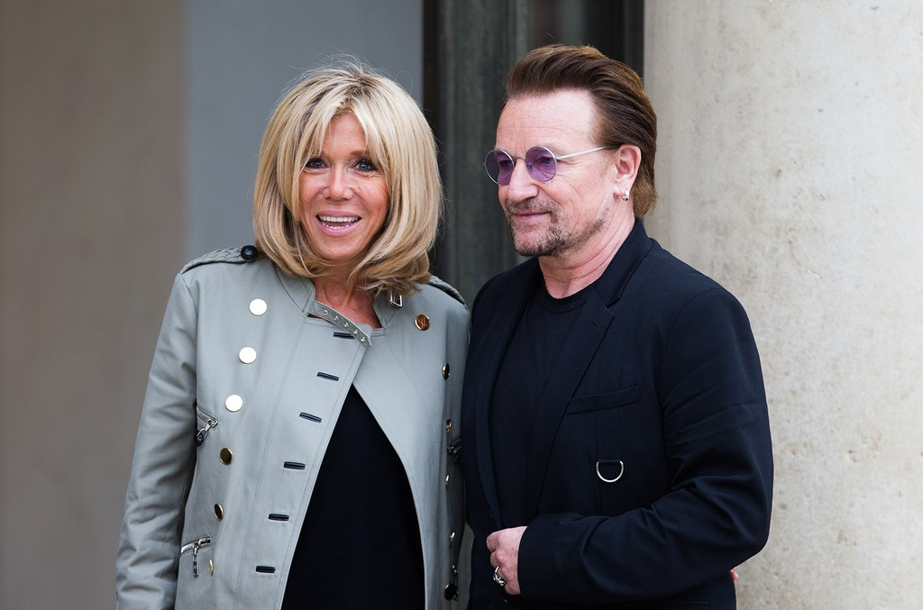 Brigitte Trogneux, Emmanuel Macron's wife, welcomes Bono of U2 at the Elysee Palace on July 24, 2017 in Paris.