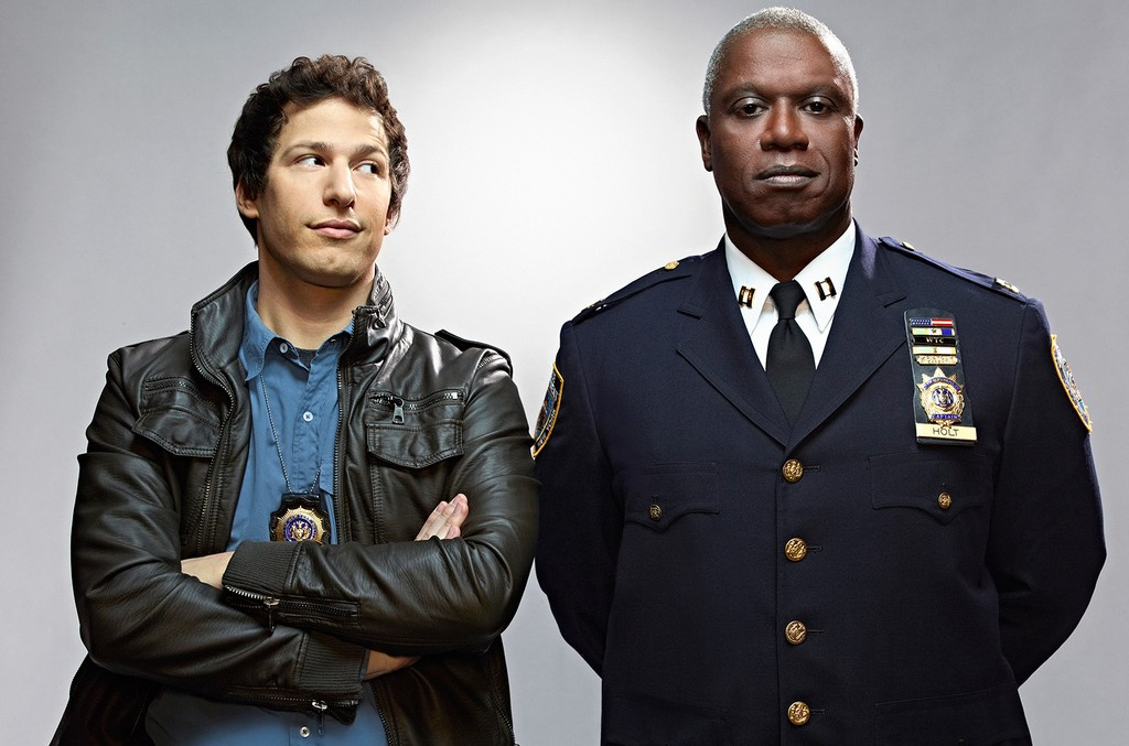 Andy Samberg as Jake Peralta and Andre Braugher as Captain Ray Holt on Brooklyn Nine-Nine.