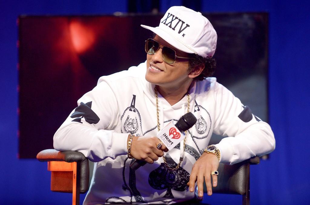 Bruno Mars speaks with host JoJo onstage at iHeartRadio Theater on Nov. 17, 2016 in Burbank, Calif.