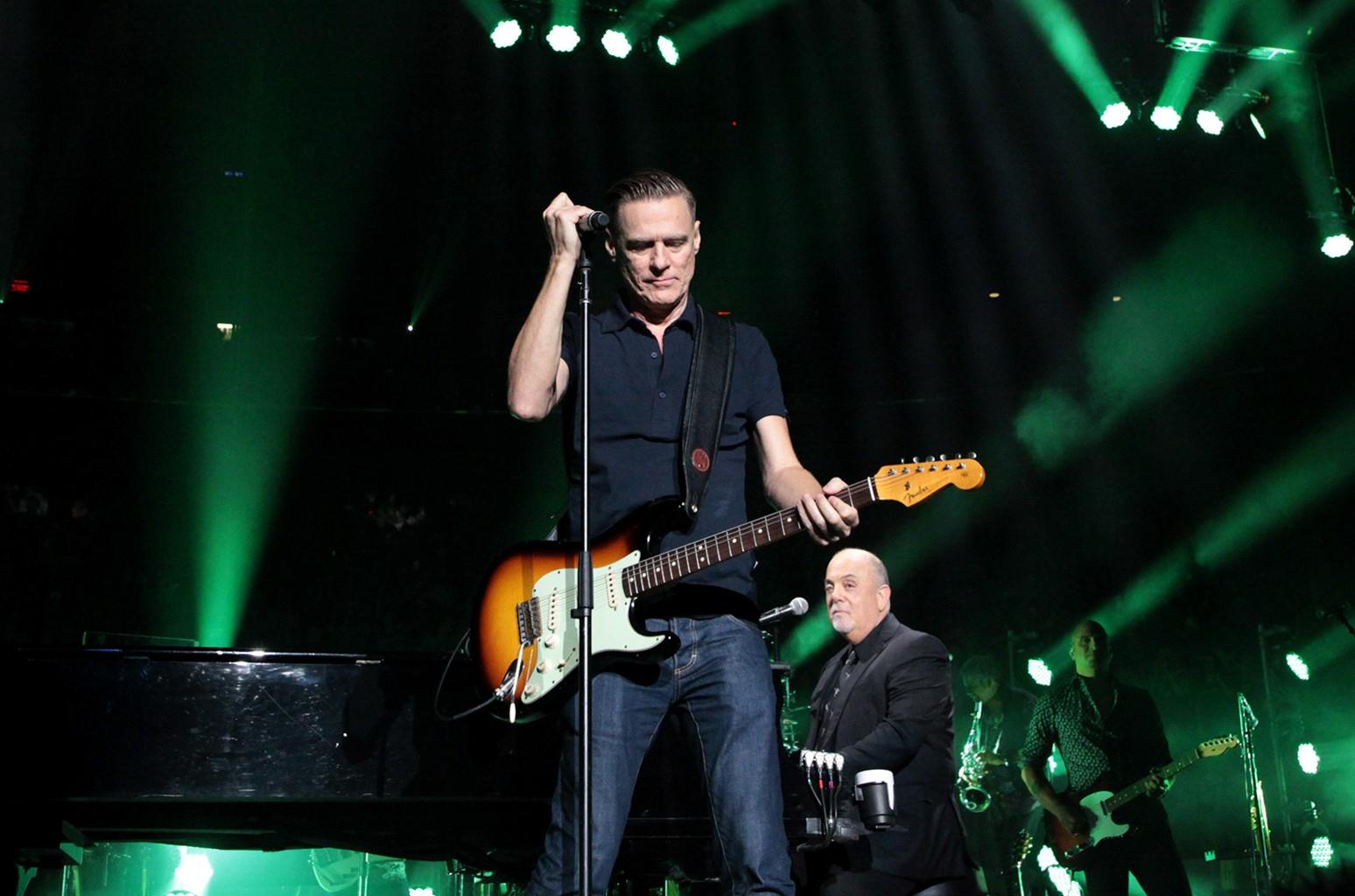 Bryan Adams and Billy Joel perform
