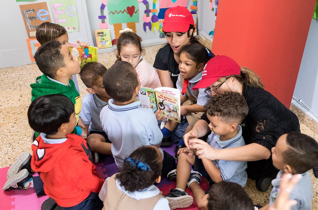 Camila Cabello and her mother participate in a reading activity with kids enrolled at a Save the Children supported day care center in Yabucoa, Puerto Rico on Oct. 24, 2018.
