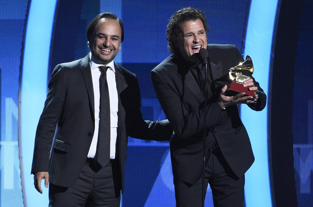 """Andres Castro and Carlos Vives accept the song of the year award for """"La Bicicleta"""" at the 17th annual Latin Grammy Awards at the T-Mobile Arena on Nov. 17, 2016 in Las Vegas."""