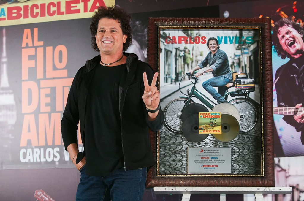 Carlos Vives poses during a press conference after reaching the gold and triple platinum disc with his album 'La Bicicleta' at Presidente Intercontinental Hotel on Jan. 31, 2017 in Mexico City, Mexico.