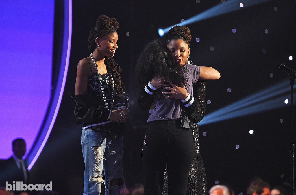 Chloe X Halle present Alessia Cara with an award on stage at the Billboard Women in Music 2016 event on Dec. 9, 2016 in New York City.