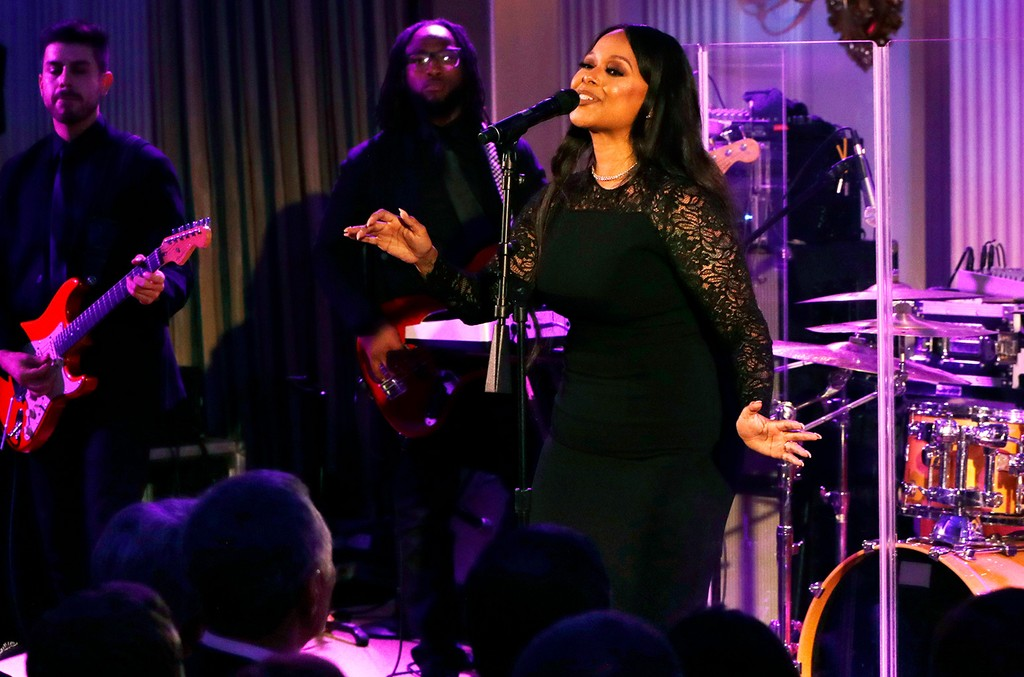 Chrisette Michele performs for President Barack Obama, first lady Michelle Obama, Singapore's Prime Minister Lee Hsien Loong, and his wife Ho Ching, in the State Dining Room of the White House during a state dinner on Aug. 2, 2016 in Washington.