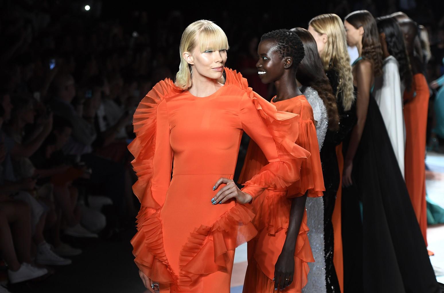 Models walk the runway at the Christian Siriano fashion show