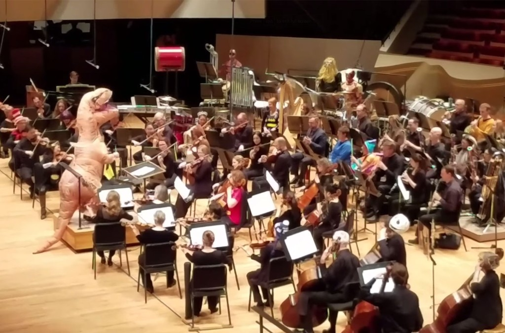 Comic Con Colorado symphony performs the 'Jurassic Park' theme song.