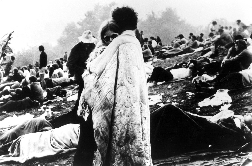 ?A couple hugs during the Woodstock Music and Art Festival in Bethel, New York in Aug. 1969.