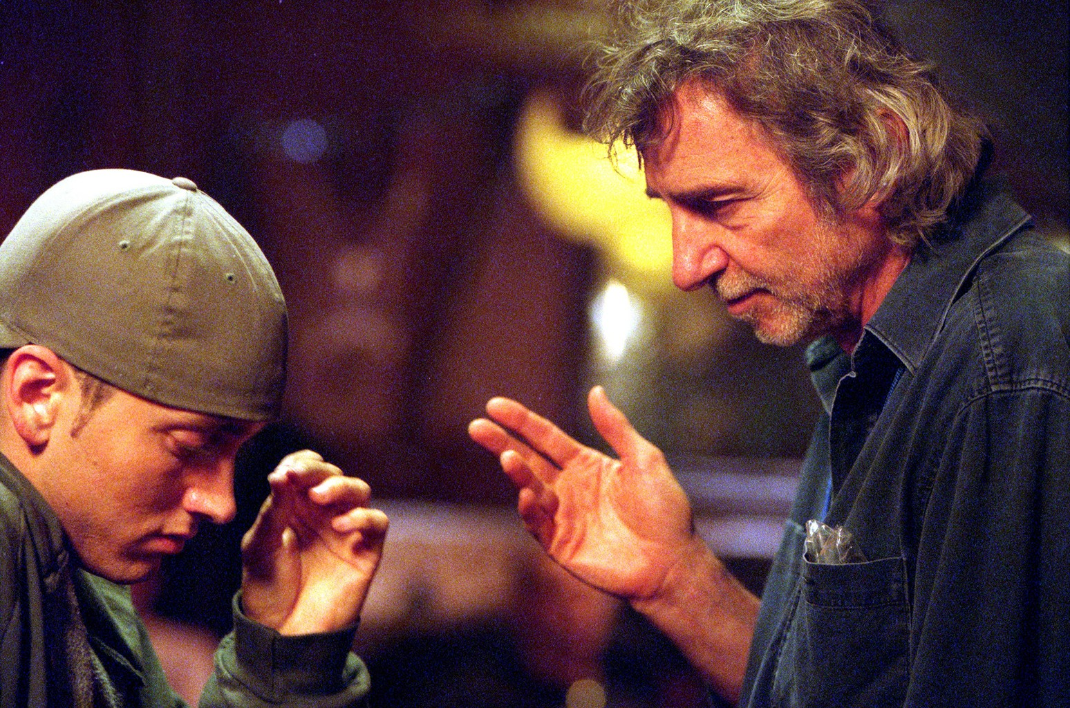 Eminem and director Curtis Hanson photographed on the set of '8 Mile' in 2002.