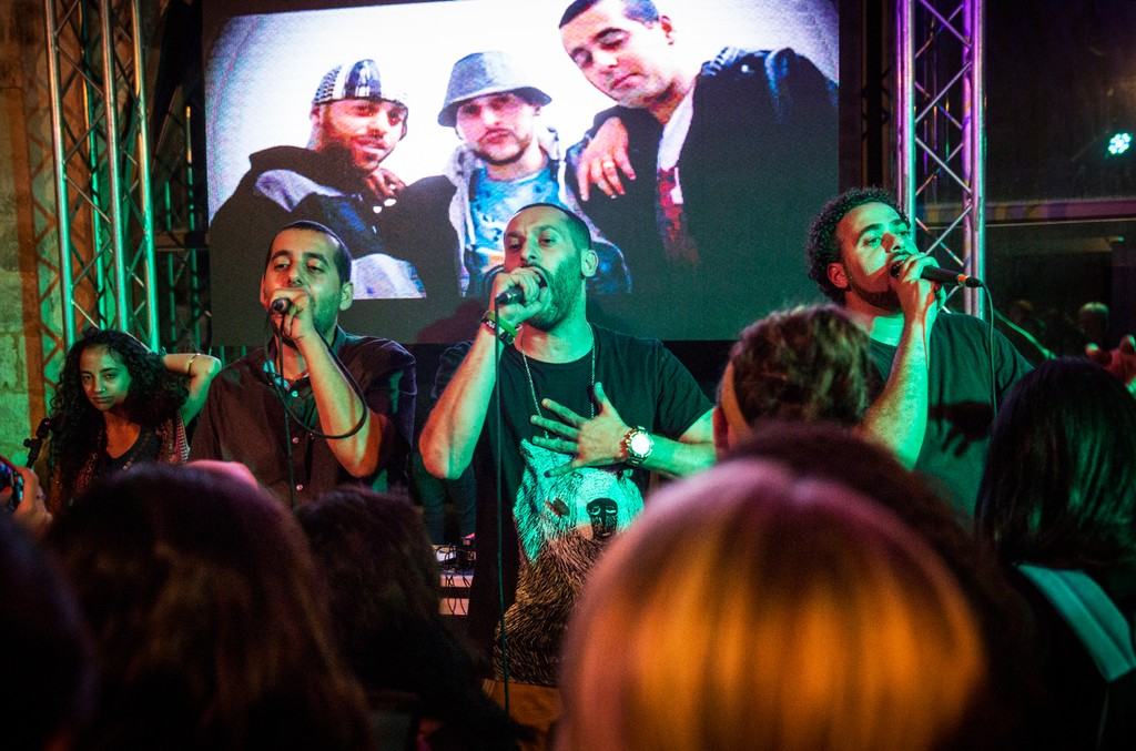 Palestinian hip-hop group DAM perform at a 2014 Palestine Festival of Literature event at Qasr al Qassem on June 4, 2014 in Beit Wazan, near Nablus, West Bank.