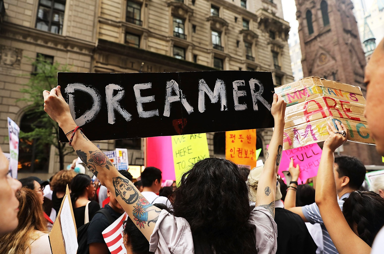Dozens of immigration advocates and supporters attend a rally outside of Trump Tower along Fifth Avenue on August 15, 2017 in New York City.