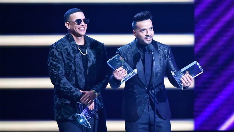 <p>Daddy Yankee and Luis Fonsi onstage at the 2018 Billboard Latin Music Awards at the Mandalay Bay Events Center on April 26, 2018 in Las Vegas.</p>
