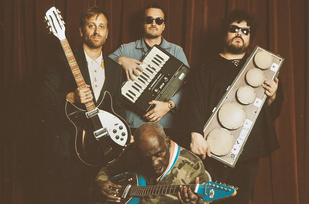 Dan Auerbach, left, with Leo 'Bud' Welch, seated, and members of The Arcs