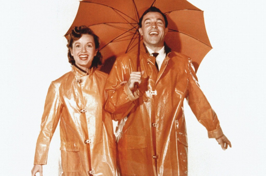 Debbie Reynolds and Gene Kelly photographed for 'Singin' In The Rain' in 1952.