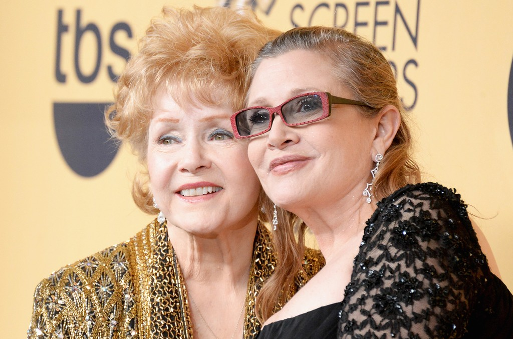 Debbie Reynolds and Carrie Fisher pose in the press room at the 21st Annual Screen Actors Guild Awards at The Shrine Auditorium on Jan. 25, 2015 in Los Angeles.