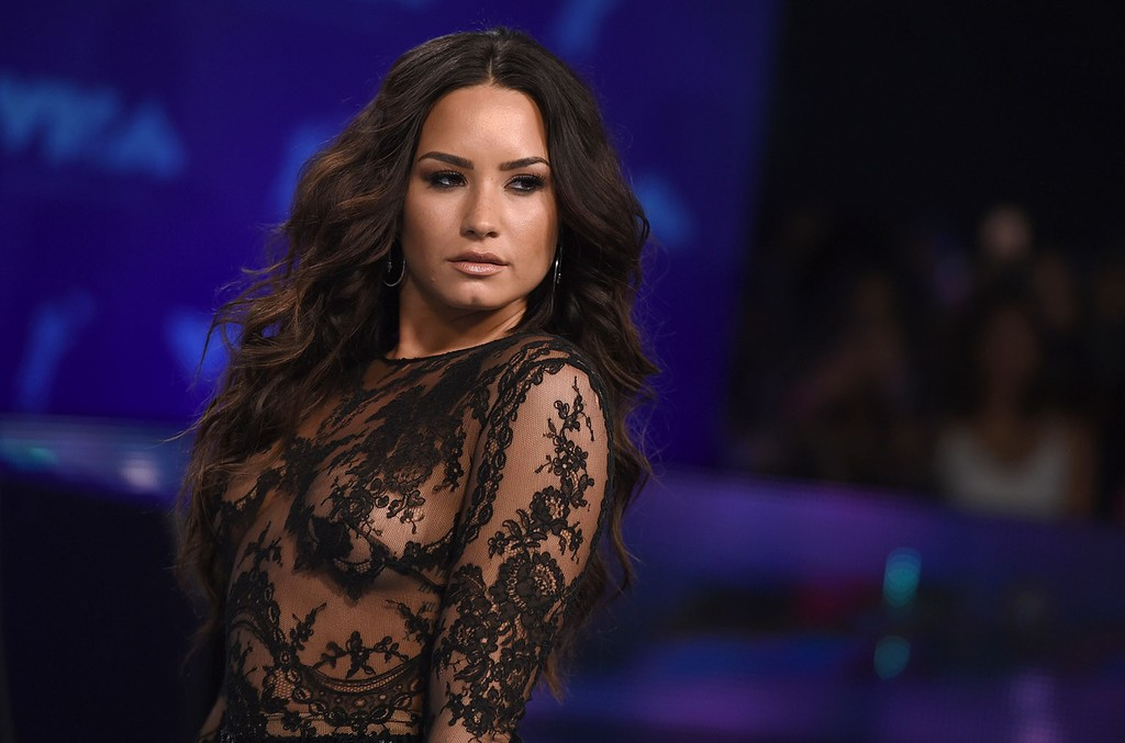 Demi Lovato arrives at the MTV Video Music Awards at The Forum in Inglewood, Calif.