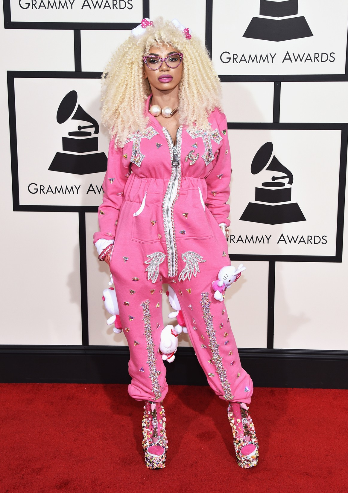 Dencia came to the 2016 Grammys in a wacky onesie covered in Hello Kitty dolls.