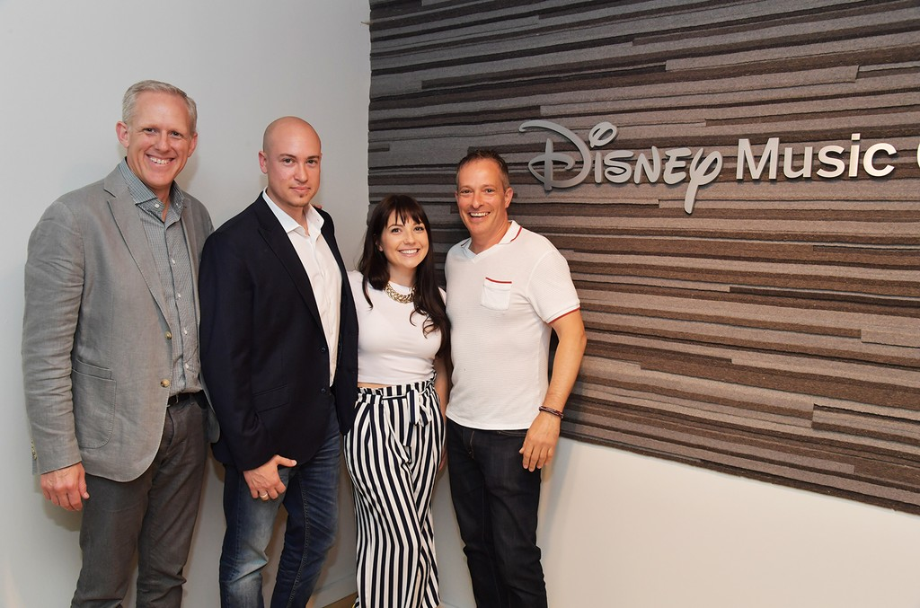 (L–R) Ken Bunt (President, Disney Music Group), Chris Rojas (Co-Founder of DigiTour Media), Meridith Valiando Rojas (Co-Founder of DigiTour Media), and Darryl Franklin (VP, Business Affairs & Legal Counsel)