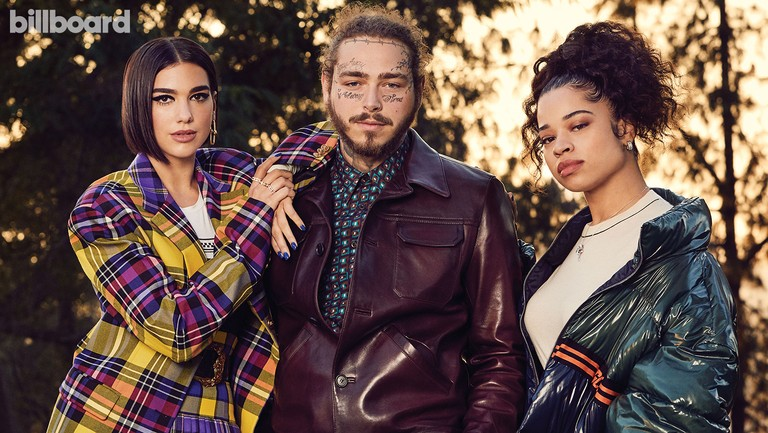 <p>From left: Dua Lipa, Post Malone and Ella Mai photographed on Sept. 24, 2018 at The Paramour Estate in Los Angeles. Styling by Jason Rembert. Lipa wears a Versace T-shirt, jacket and skirt, and Tiffany &amp&#x3B; Co. earrings. Post Malone wears a Prada shirt, jacket and pants. Mai wears a Helmut Lang sweater, GCDS coat, Tiffany &amp&#x3B; Co. ring and Piaget earrings and ring.</p>